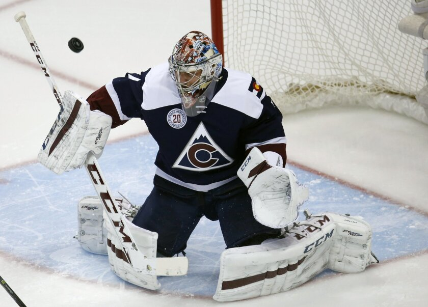 Colorado Avalanche goalie Semyon Varlamov, of Russia, deflects a shot off the stick of a Winnipeg Jets player in the first period of an NHL hockey game Saturday, Feb. 6, 2016, in Denver. (AP Photo/David Zalubowski)