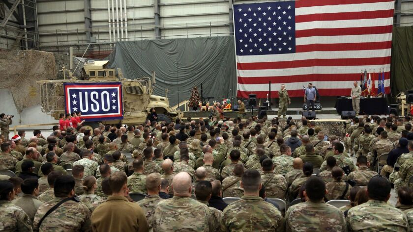 U.S. Troops attend a ceremony on Christmas Eve at a U.S. airfield in Bagram, Afghanistan on Dec. 24.