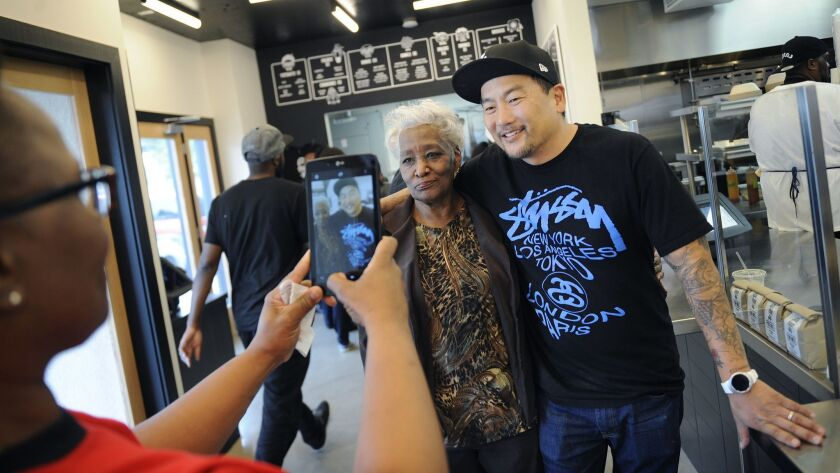 Tabitha O'Neal, left, takes a photo of her mother, Delores, with Chef Roy Choi before dining at Locol in January 2016.