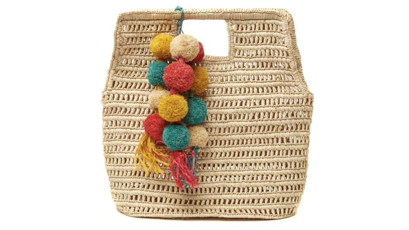 The handwoven Nola tote by Mar Y Sol bears a structured shape that elevates it from a beach essentia