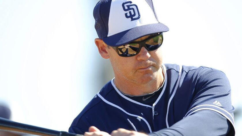 San Diego Padres instructor Mark Loretta hits balls during a spring training practice.