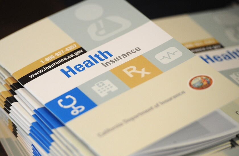 Booklets outlining health insurance options.