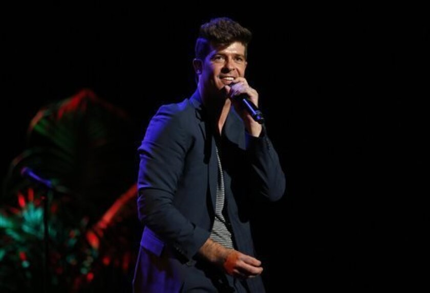 """FILE - This Sept. 15, 2012 file photo originally released by Point Foundation shows singer Robin Thicke performing at the """"Voices On Point"""" Concert & Gala in Los Angeles. Thicke's, """"Blurred Lines,"""" was the most viral track on Spotify from Monday, March 25, to Sunday, March 31.  (AP Photo/Point Foun"""