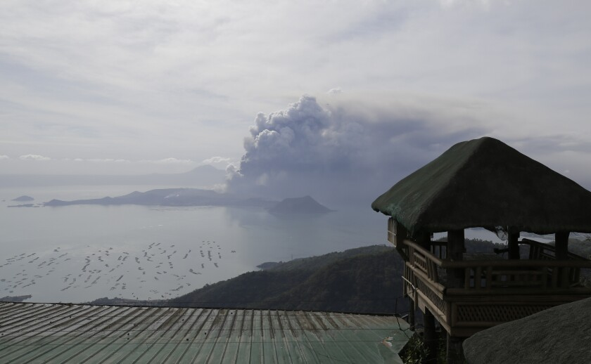 Taal volcano continues to erupt in Lemery, Batangas, southern Philippines on Monday, Jan. 13, 2020. Red-hot lava gushed out of a volcano near the Philippine capital on Monday, as thousands of people fled the area through heavy ash. Experts warned that the eruption could get worse and plans were being made to evacuate hundreds of thousands. (AP Photo/Aaron Favila)