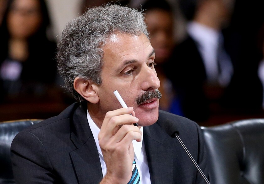 L.A. City Atty. Mike Feuer makes a case against electronic cigarettes before the City Council voted Tuesday to restrict their use.