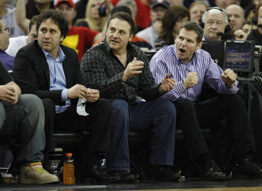 From left, George, Gavin and Joe Maloof sit courtside during a Sacramento Kings game against the Los Angeles Clippers in Sacramento in 2011.