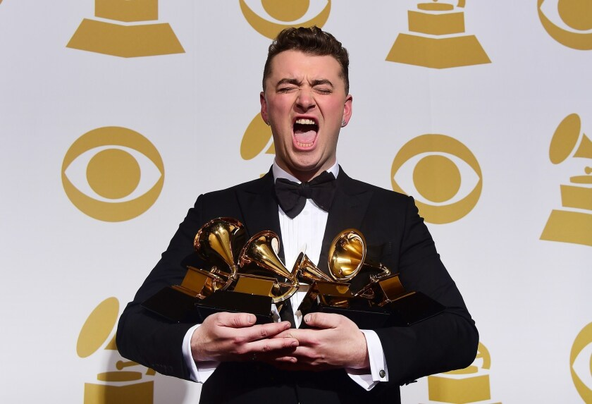 Sam Smith holds the four awards he collected Feb. 8 at the Grammy Awards in Los Angeles.
