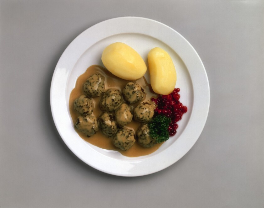 Ikea is developing a vegetarian and a chicken version of its popular Swedish meatballs. Pictured is a plate of the original meatballs with boiled potatoes and Lingonberry jam.