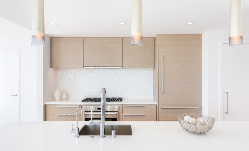 Shown here is a chef-caliber kitchen with breakfast bar in a Pacific Gate residence.