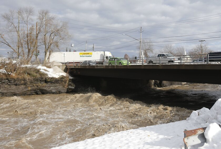 Runoff swells Buffalo Creek in West Seneca, N.Y., where snow from a freak early winter blizzard is melting. A new study says such aberrant events do little to change people's views on climate change science.