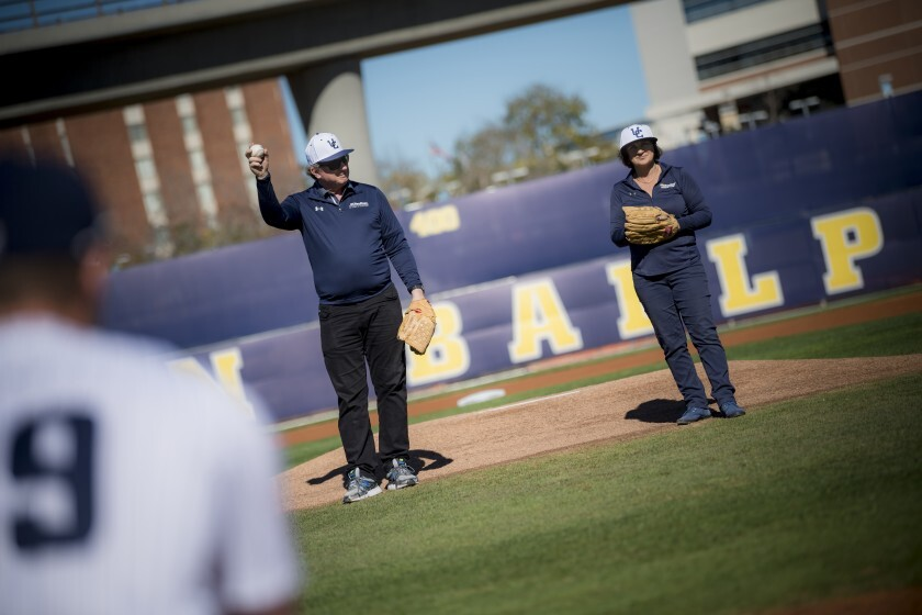 UC San Diego alumnus Gary Jacobs with his wife, Jerri-Ann, threw out the first pitch at the Triton baseball season opener Feb. 1. The local philanthropists have been longtime supporters of baseball at the university.