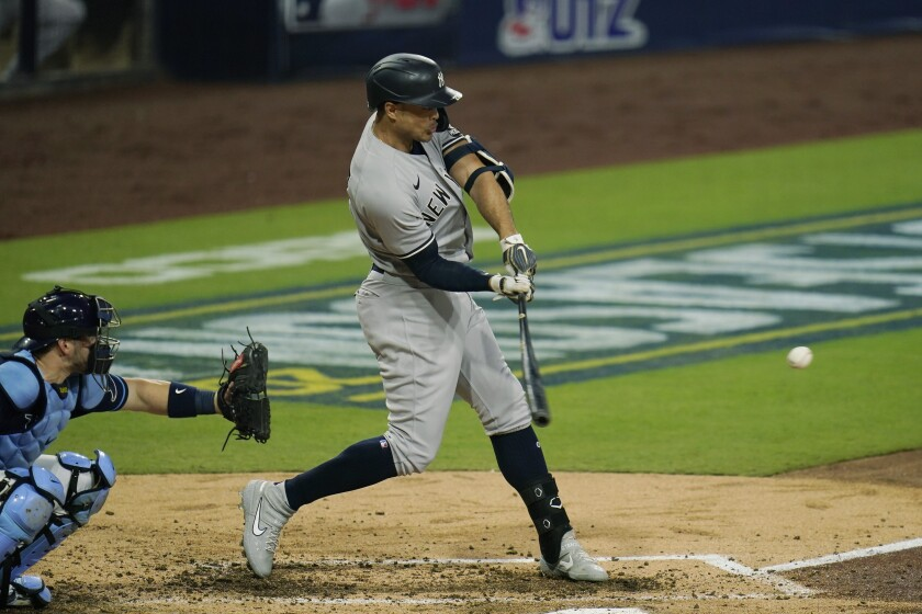 Yankees DH Giancarlo Stanton hits a three-run homer in the fourth inning against Tampa Bay in Game 2 of ALDS at Petco Park.