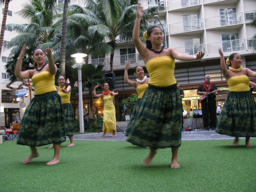 Hawaii is an annual destination for California lawmakers. Above, hula dancers perform in Waikiki.