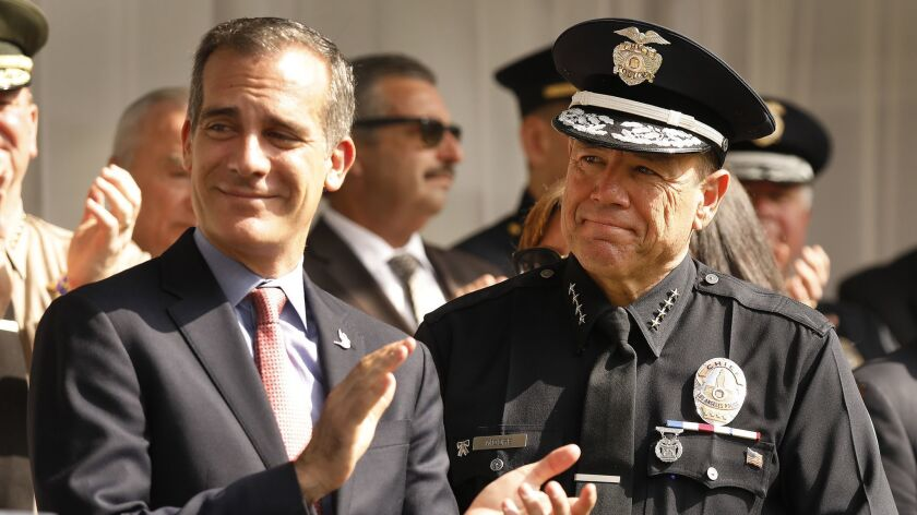 LOS ANGELES, CA – JUNE 28, 2018: Los Angeles Mayor Eric Garcetti, left, with the new LAPD Chief M