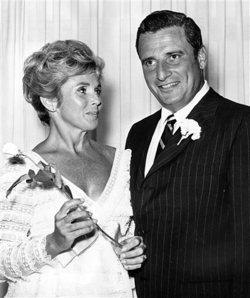 FILE - In this July, 1969 file photo, the NFL president and Cleveland Browns owner Art Modell and his wife Patricia are shown in Las Vegas. Patricia Modell, a longtime television actress and wife of former NFL team owner Art Modell, died Wednesday, Oct. 12, 2011, the Baltimore Ravens announced. She was 80. (AP Photo/File)