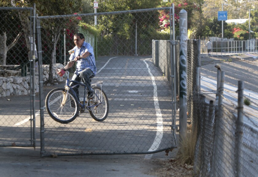 A bicycle rider turns off the bike path at its end at Egret Park in Los Angeles in June 2014.