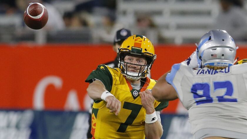 Arizona Hotshots quarterback John Wolford (7) throws down field against the Salt Lake Stallions in t