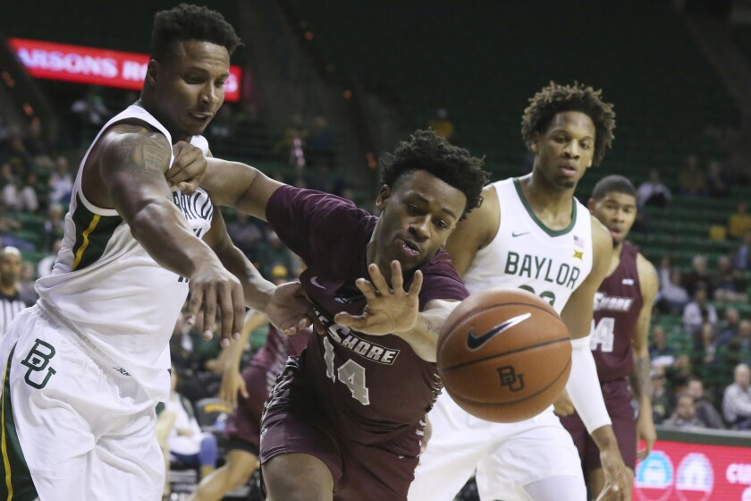 Maryland-Eastern Shore forward Bruce Guy, right, pushes off on Baylor guard Mark Vital, left, while reaching for a loose ball in the first half of an NCAA college basketball game, Tuesday, Dec. 3, 2019, in Waco, Texas. (AP Photo/Rod Aydelotte)