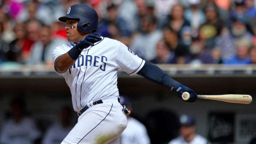 Padres second baseman Yangervis Solarte hits an RBI single during the seventh inning against the Kansas City Royals at Petco Park.