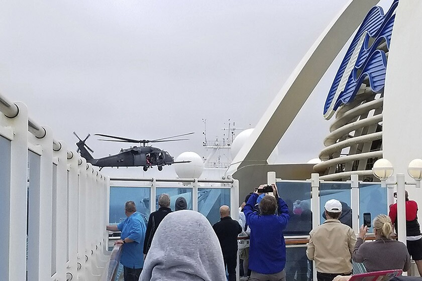 A National Guard helicopter hovers over the Grand Princess cruise ship off the coast of California on Thursday.