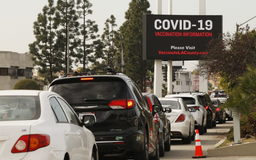 Cars line up as Angelenos try to get vaccinated in Inglewood.