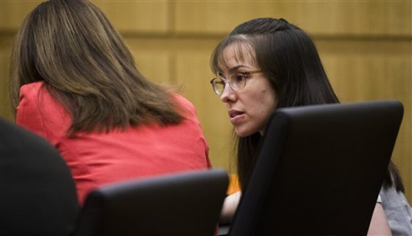 Jodi Arias asks a question of her attorney, Jennifer Willmott , left, while Judge Sherry Stephens, prosecutor Juan Martinez and defense attorneys Kirk Nurmi and Willmott  go over questions submitted by jurors in the murder trial of Jodi Arias, Wednesday March 6, 2013, in Maricopa County Superior C