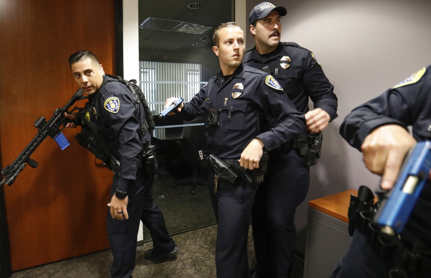 With weapons drawn during an active shooter drill, San Diego police officers search for the shooter on the 14th floor of the Emerald Plaza office building, August 17, 2019, in downtown San Diego. The drill began in the lobby of the adjoining Westin San Diego Hotel.