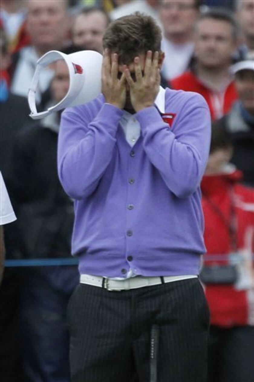 Jeff Overton reacts on the 6th green after missing a shot on the second day of the 2010 Ryder Cup golf tournament at the Celtic Manor Resort in Newport, Wales, Saturday, Oct. 2, 2010. (AP Photo/Alastair Grant)