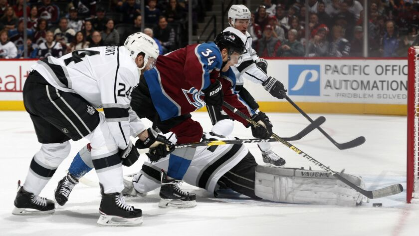 Colorado Avalanche center Carl Soderberg, second from front, tries to score a goal as, from front to back, Kings defenseman Derek Forbort, goaltender Jack Campbell and right wing Tyler Toffoli defend in the third period.