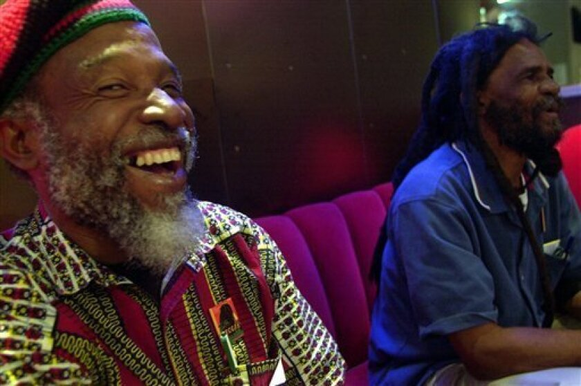 """FILE - In this June 7, 2001 file photo, Jamaican musician Cedric Brooks, left, laughs next to Ska pioneer Johnny """"Dizzy"""" Moore as they talk about their days at the Alpha Boys School in Kingston, Jamaica at the Experience Music Project in Seattle, Washington. One of Brooks' sisters, Paulette Keise, said he died Friday, May 3, 2013 of cardiac arrest at New York Hospital Queens. He was 70. Brooks began his music career in the late 1960s as a studio musician, playing in songs such as Burning Spear'"""