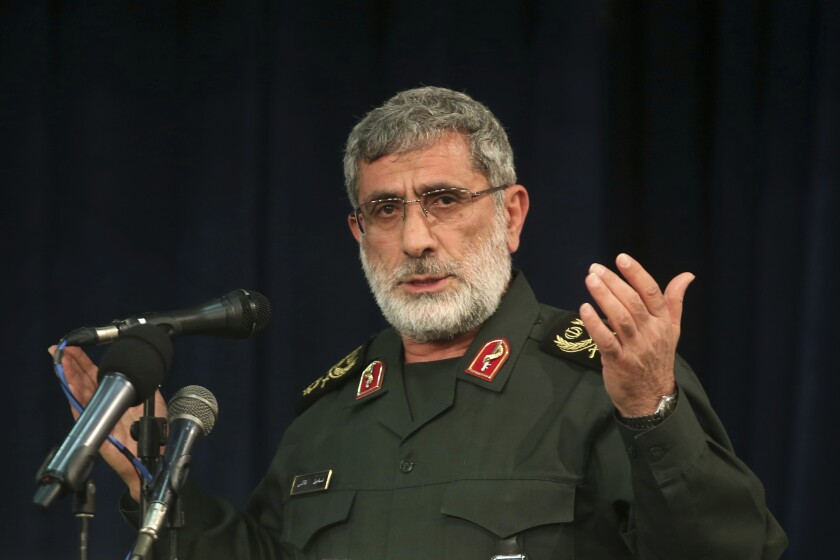 """In this Nov. 5, 2016 photo, Gen. Esmail Ghaani speaks in a meeting in Tehran, Iran. A new Iranian general has stepped out of the shadows to lead the country's expeditionary Quds Force, becoming responsible for Tehran's proxies across the Mideast as the Islamic Republic threatens the U.S. with """"harsh revenge"""" for killing its previous head, Qassem Soleimani. (Mohammad Ali Marizad/Tasnim News Agency via AP)"""