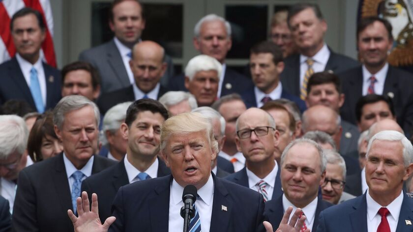 President Trump celebrates with fellow Republicans in the Rose Garden after the House passed legislation to replace the Affordable Care Act.