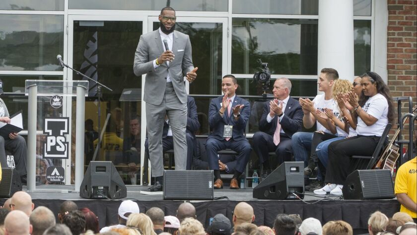 LeBron James speaks at the opening ceremony for the I Promise School in Akron, Ohio, Monday, July 30