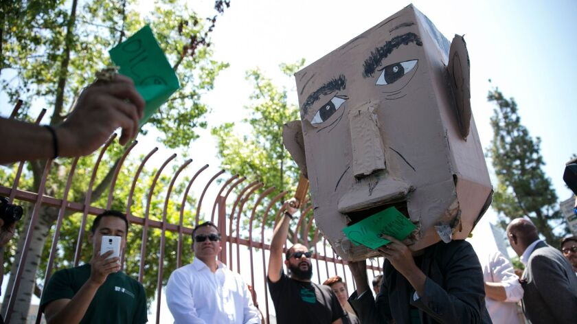 Members of the East Yard Communities for Environmental Justice demonstrate against Gov. Jerry Brown