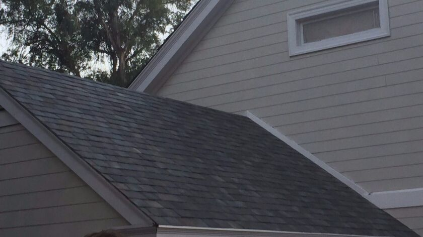 """One style of the line of solar tile roofs that Tesla and SolarCity plan to manufacture, shown on a """"Desperate Housewives"""" home at Universal Studios Hollywood."""