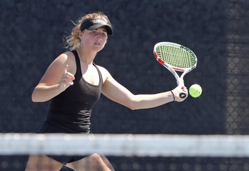 Huntington Beach No. 1 singles player Kaytlin Taylor runs down a volley on Tuesday afternoon.