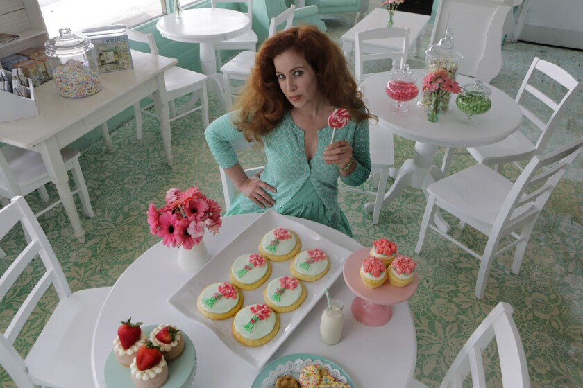 Elizabeth Harris shows off some of her desserts and sweets at her Elizabethan Desserts store in Encinitas Tuesday. (Bill Wechter)