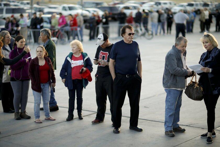Voters line up outside a Republican caucus site, Tuesday, Feb. 23, 2016, in Las Vegas. (AP Photo/John Locher)