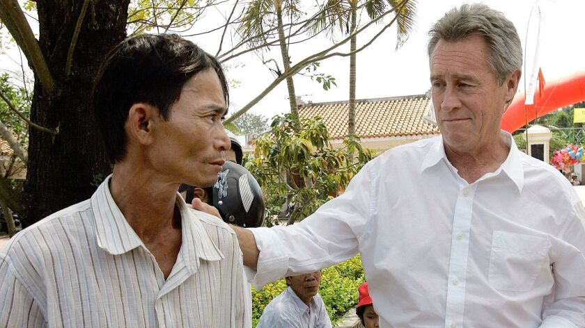 My Lai massacre survivor Do Ba, left, meets on March 15, 2008, with former U.S. Army officer Lawrence Colburn, who helped stop the massacre 40 years before.