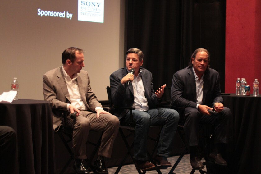 """Ted Sarandos speaks during the """"New Era of TV"""" panel, next to Ed Carroll (AMC Networks), left, and Steve Mosko (Sony Pictures Television)."""
