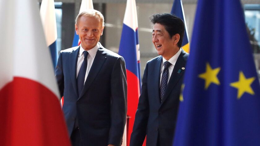 Japan's PM Abe is welcomed by EU Council President Tusk at the start of a EU-Japan summit in Brussels
