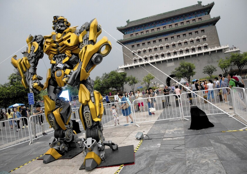 """A model of """"Transformers"""" character Bumblebee is displayed in Beijing as part of a promotion of the movie """"Transformers: Age of Extinction."""""""