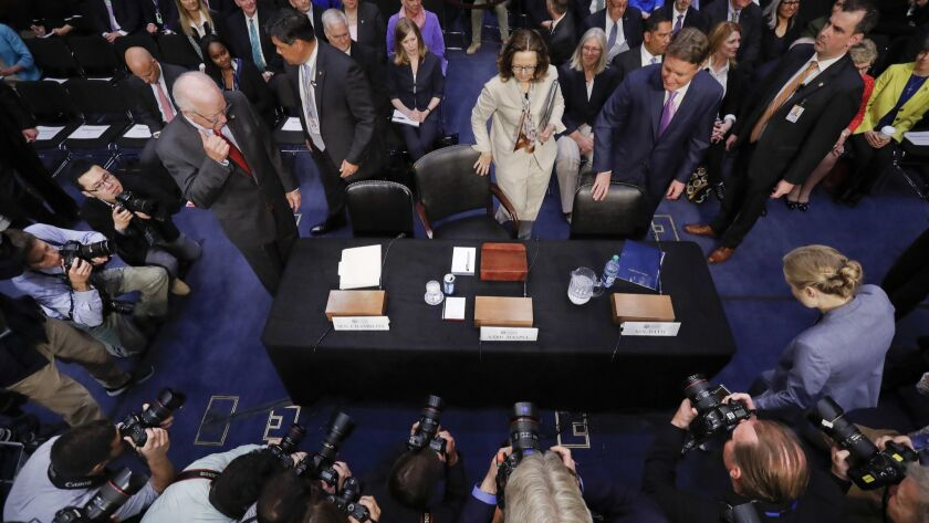 Gina Haspel, President Trump's nominee to lead the CIA, takes her seat for her confirmation hearing before the Senate Intelligence Committee on Wednesday.