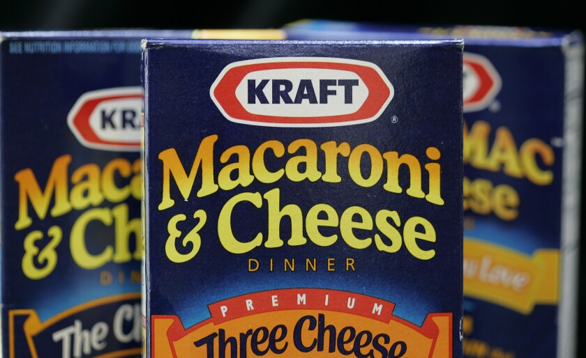 Boxes of Kraft Macaroni & Cheese. Kraft recently announced it would stop using synthetic dye in its macaroni and cheese products made in the U.S.