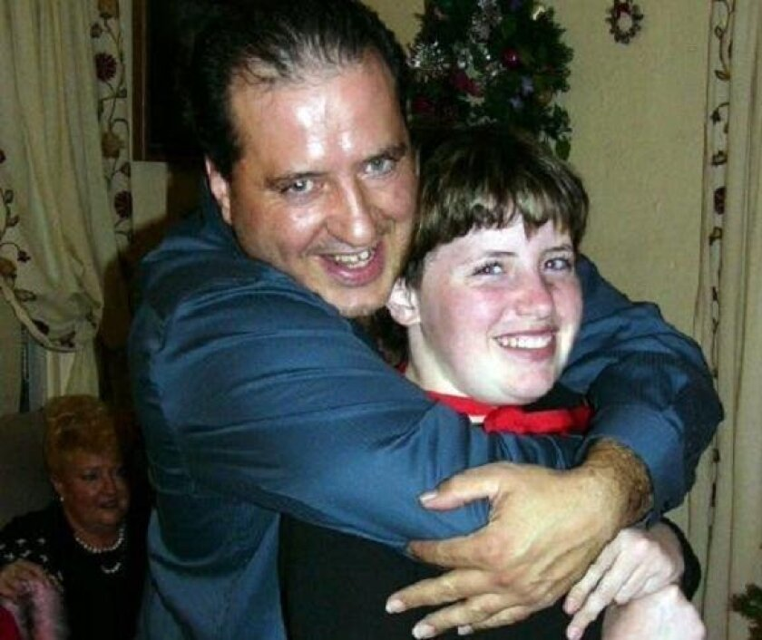 Amber Dubois, then 13, and her father, Moe Dubois, at a family Christmas party.