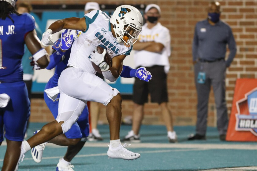 Coastal Carolina running back Reese White runs for a touchdown against Kansas during the second half of an NCAA college football game in Conway, S.C., Friday, Sept. 10, 2021. Coastal Carolina won 49-22. (AP Photo/Nell Redmond)