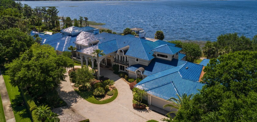 NBA icon Shaquille O'Neal has offered up his Florida compound, complete with a 31,000-square-foot mansion and 6,000-square-foot basketball court, for $28 million.