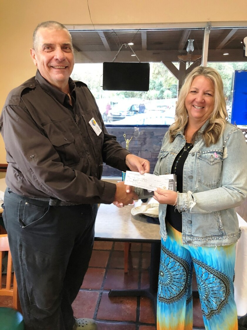 Brad Wiscons, president of The Kiwanis Club of Sunrise Vista, recently presented a check from the club for $400 to Debbie Medrano of Vista Teen Outreach.