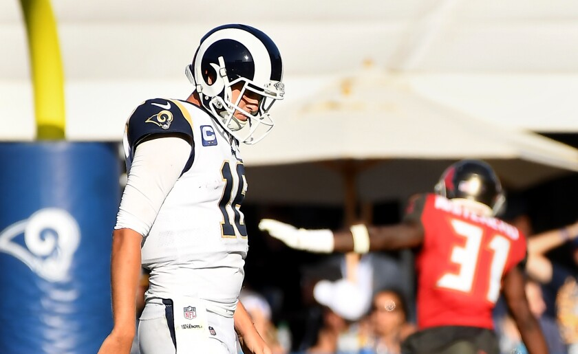 Jared Goff walks off the field after fumbling the ball late in the fourth quarter.