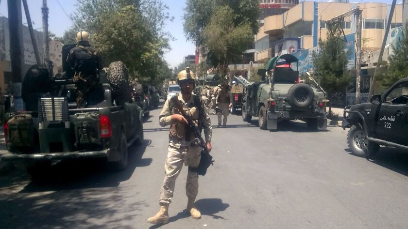 Afghan security forces arrive at the site of an explosion in Kabul on July 31.